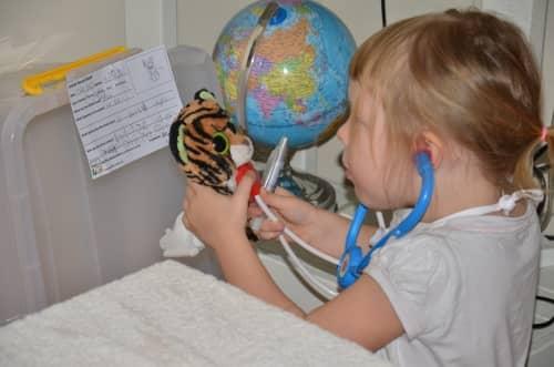 Kids playing vet