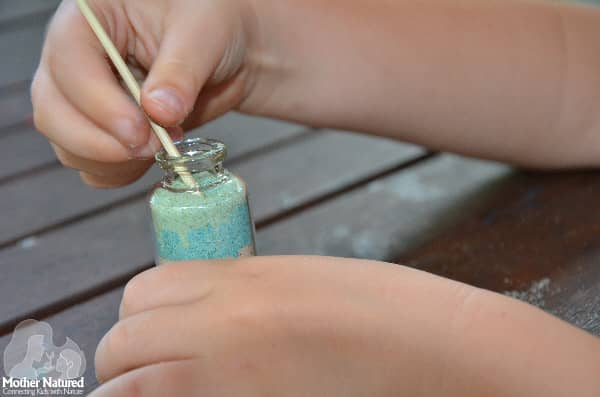 Adding Sand in a Bottle