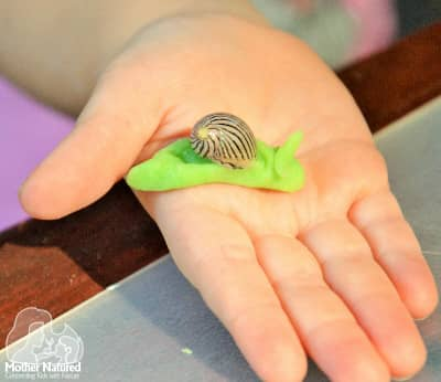 Playdough and shells: so much fun for little ones