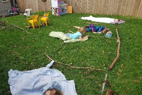 Building a stick house builds creative and confident kids