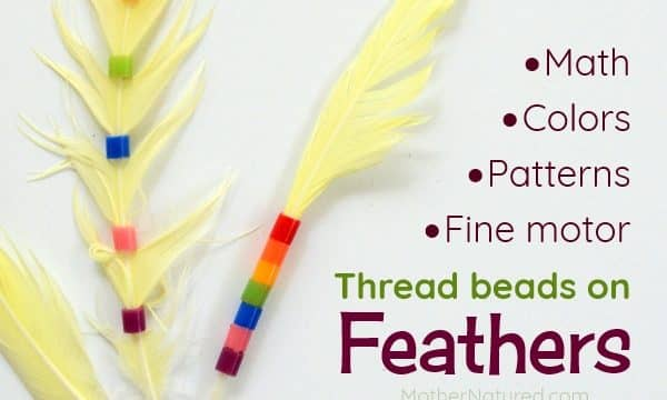 Threading beads onto Feathers: fine motor play and more