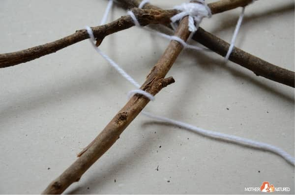 Twist yarn around stick web